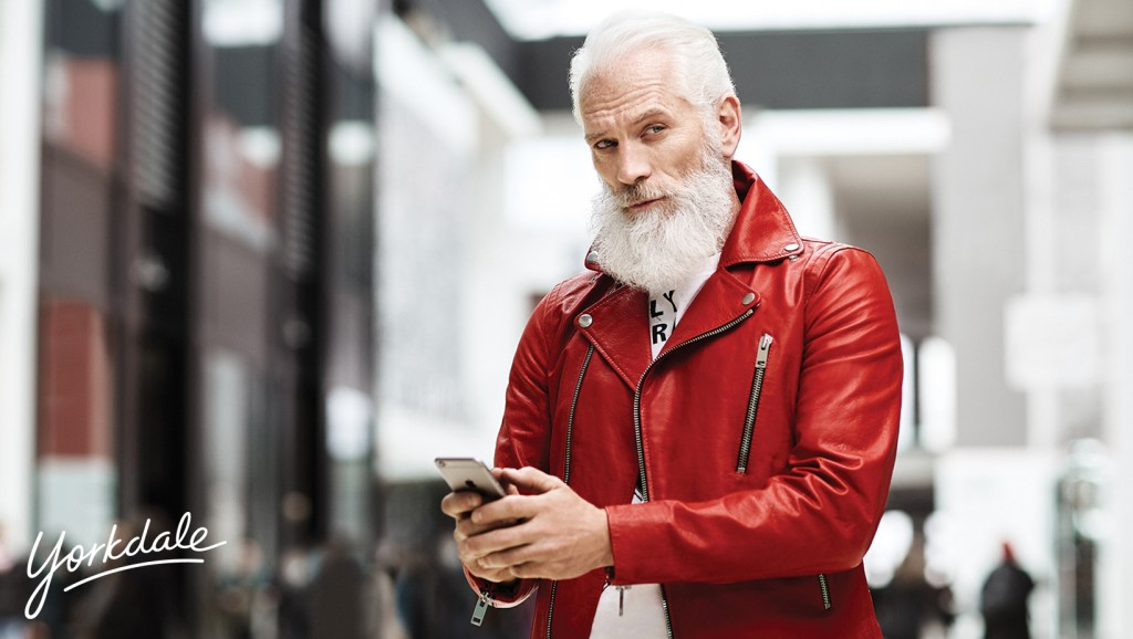 a very modern santa claus models designer clothes at yorkdale shopping mall in toronto
