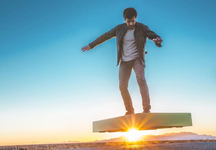 Man Riding ArcaBoard at Sunset