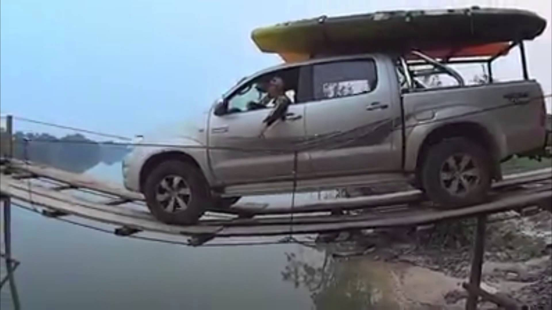Boat Towing Pickup Truck Makes a Nerve Wracking Trip Across Water on Tiny  Wooden Bridge