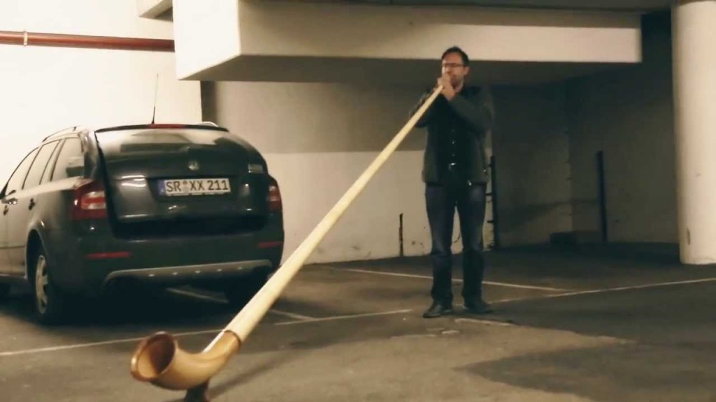 German Musician Plays a Resounding Tune on His Alpine Horn in a Bavarian Underground Garage