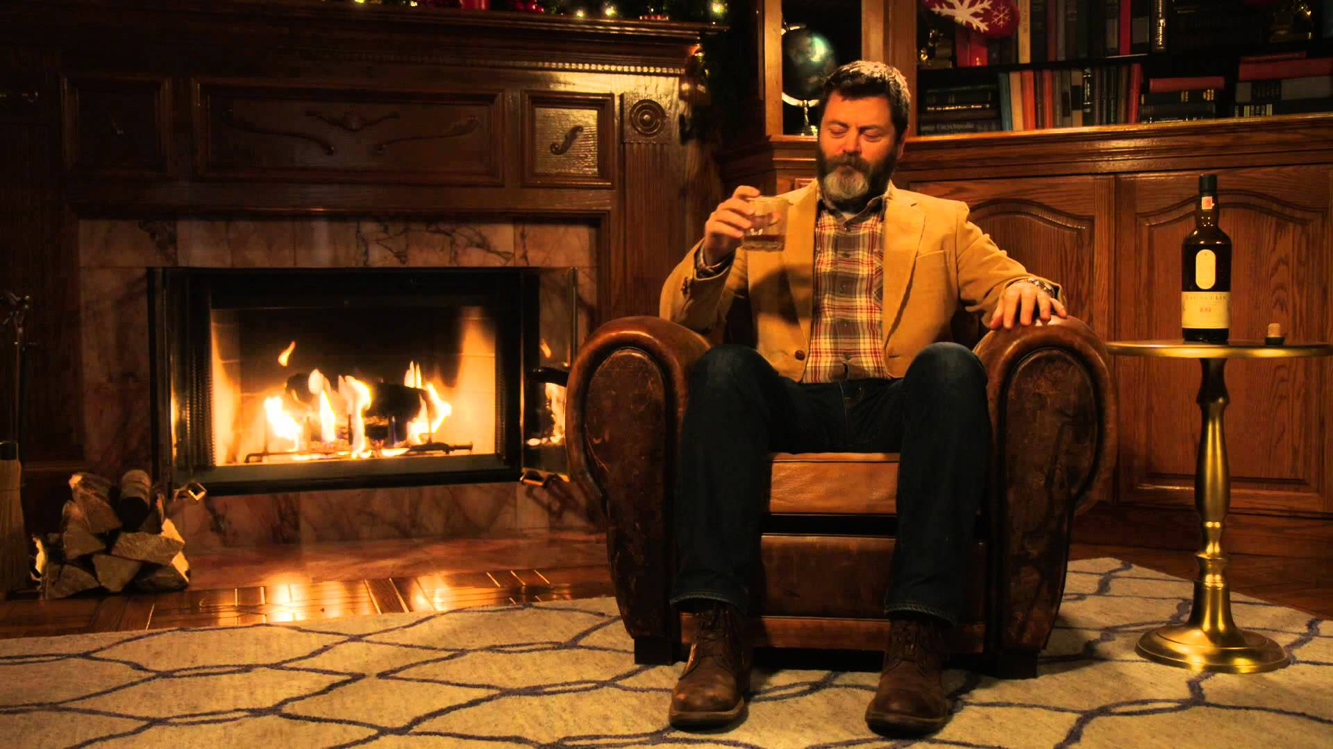 nick offerman silently drinks single malt scotch whisky in front