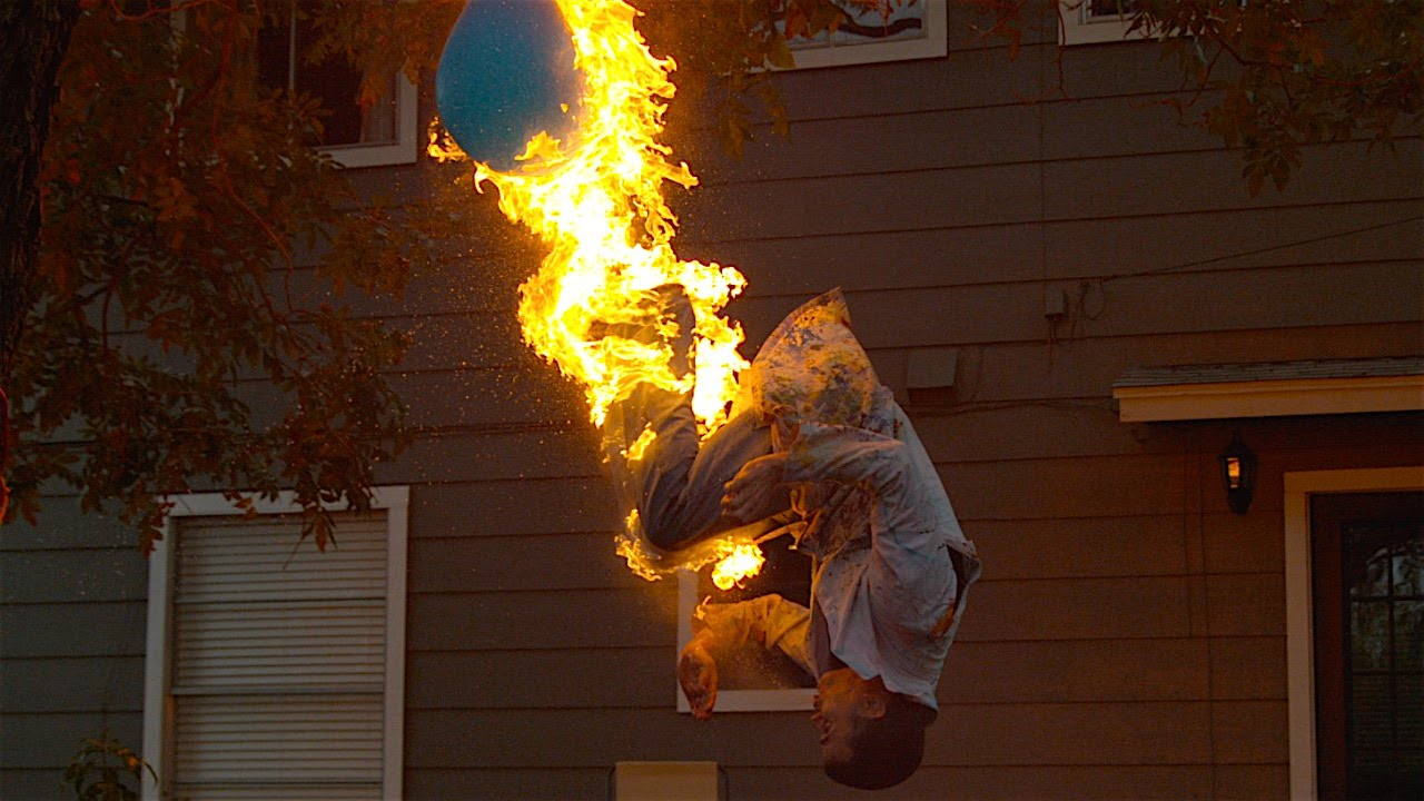Steve O Does A Fire Breathing Backflip And Pops A Balloon Filled With Water In Slow Motion