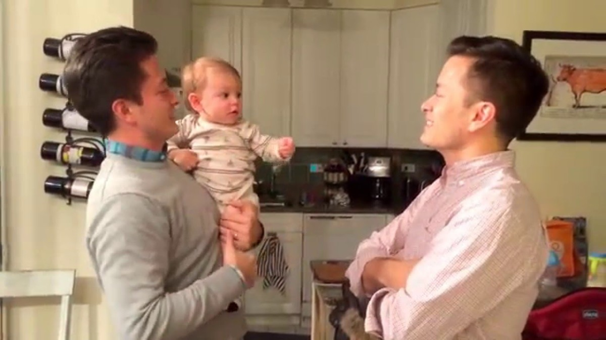 A Young Baby Gets Confused When Being Held by His Father and His Father's Twin Brother
