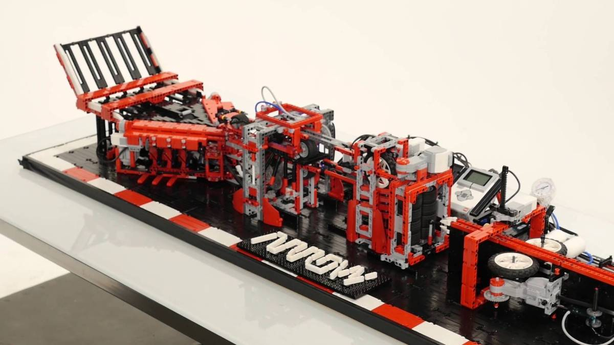 An Elaborate LEGO Machine That Folds and Launches Beautiful Paper Airplanes