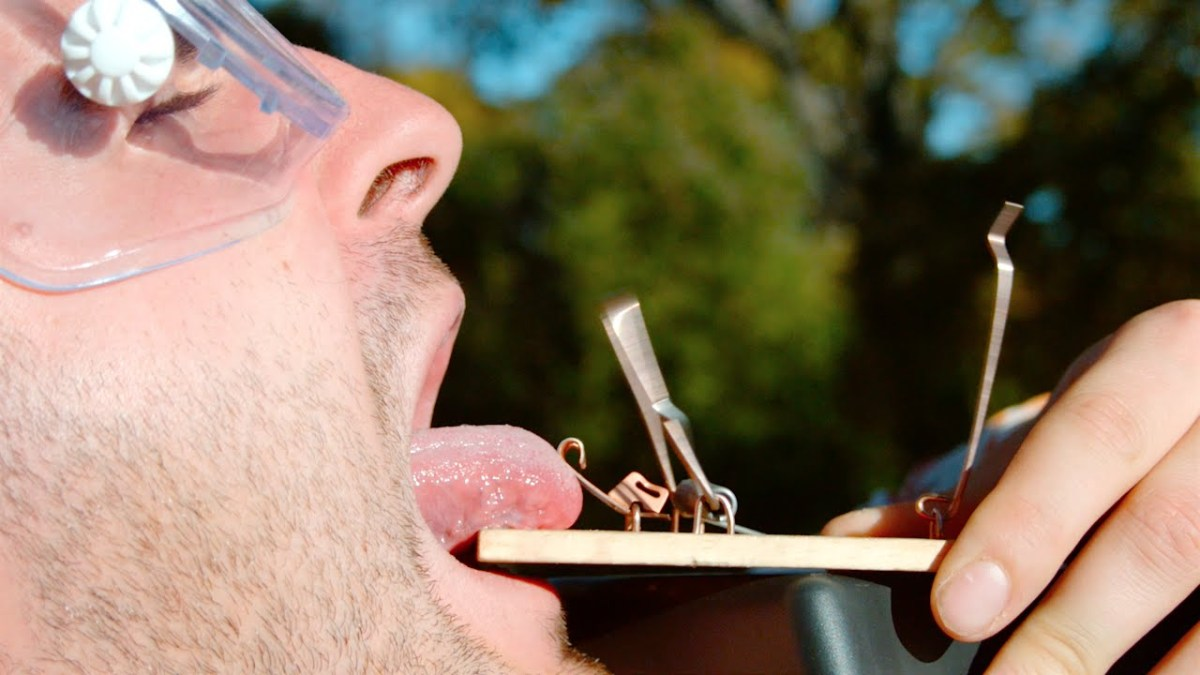 The Slow Mo Guys Capture a Mouse Trap in Action as it Snaps Down on an Unfortunate Human Tongue