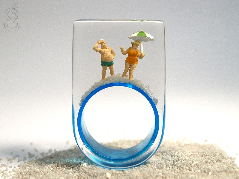 Unique Translucent Rings With Amusing Dioramic Scenes Embedded in Resin