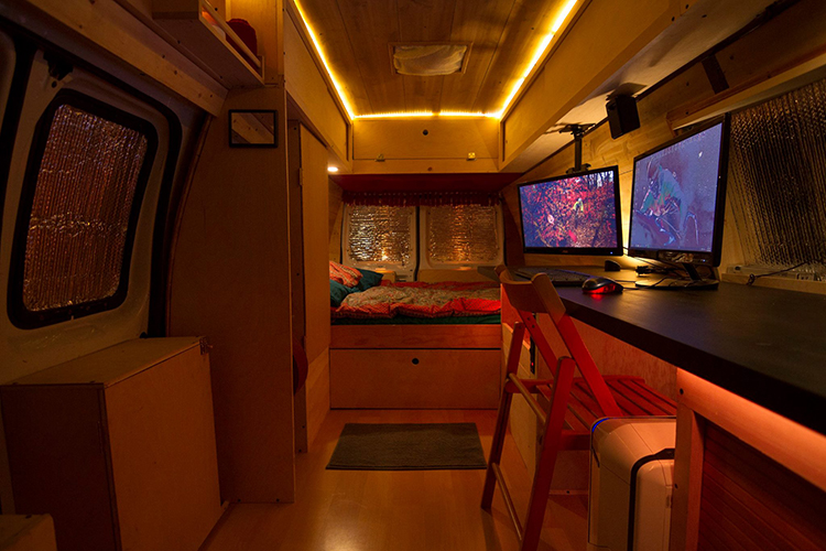 Photographer Turns An Old Nypd Surveillance Van Into A Cozy Mobile Home