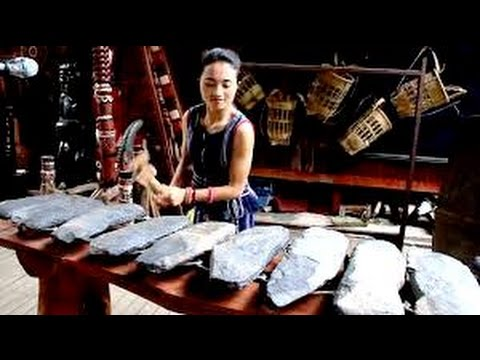 A Woman Brilliantly Plays a Tune on an Ancient Vietnamese Lithophone Made From Stones
