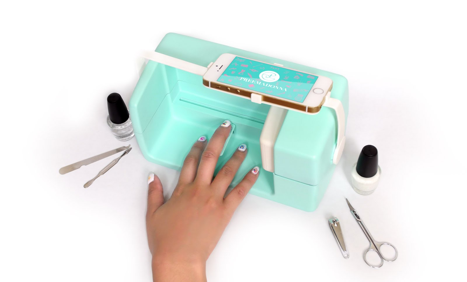 The Nailbot, A Smartphone Enabled Robot That Prints Custom Designs Directly Onto Fingernails