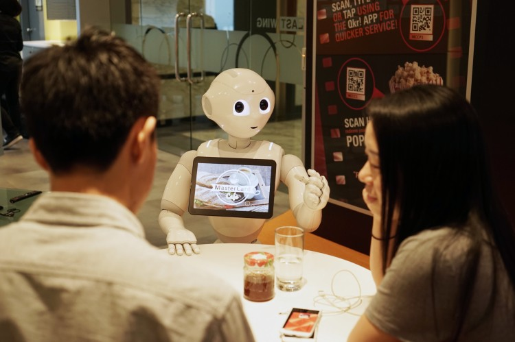 Pepper Robot With Customers at Table