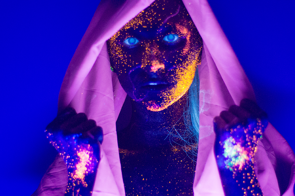 Model Painted With Glowing Makeup