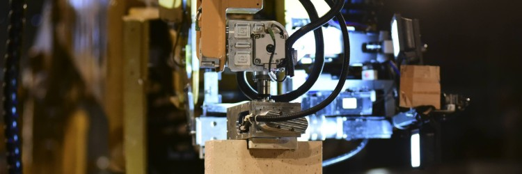 Hadrian Bricklayer Robot Holding Brick