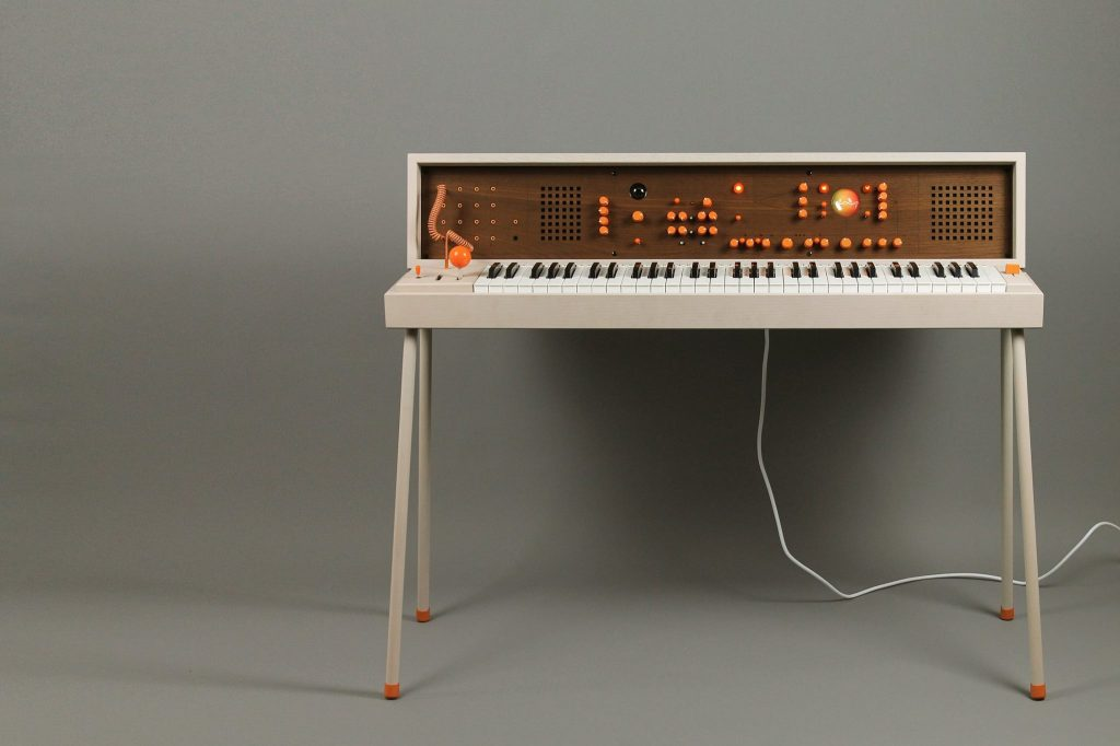 a diy modular synthesizer encased in a beautiful 1970s era keyboard stand with a fold over top. Black Bedroom Furniture Sets. Home Design Ideas