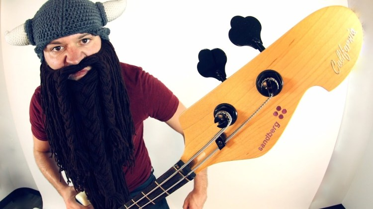 an oddly bearded rob scallon takes one string guitar to the next level with a two string bass. Black Bedroom Furniture Sets. Home Design Ideas