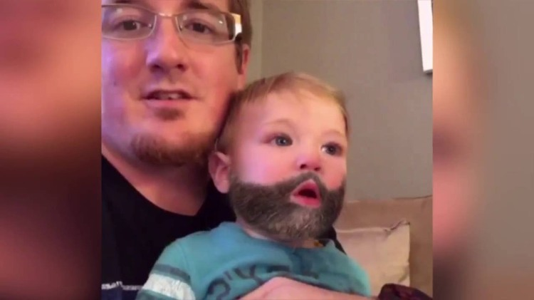 Baby Sneezes Off Snapchat Beard Transferring It Onto His Dad's Face
