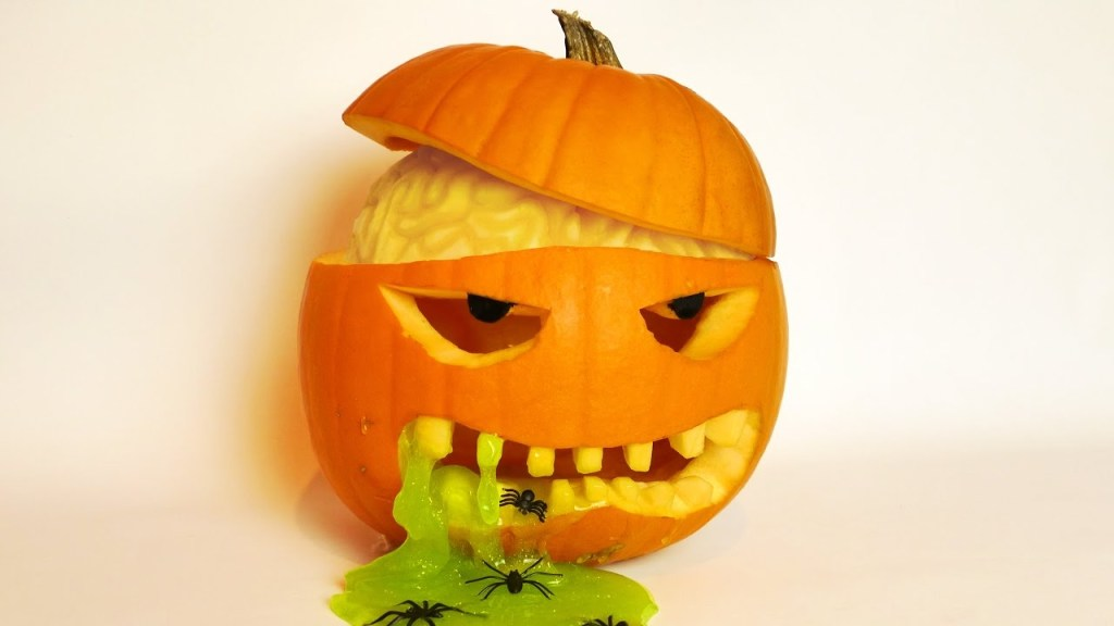 How to Carve a Pumpkin Featuring a Visible Brain and Green Slime Oozing Out of Its Mouth