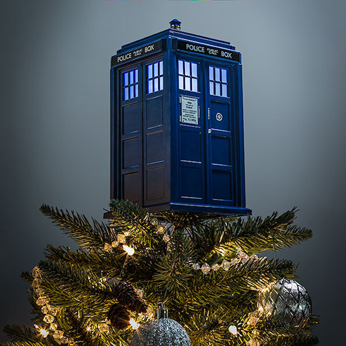 A Miniature Doctor Who Tardis That Sits On Top Of A