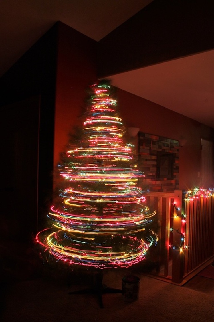 the dancing lights of a spinning christmas tree photographed with an