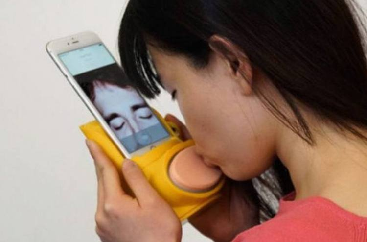 Woman Using Kissenger
