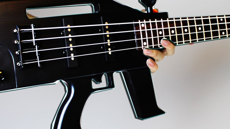 Talented Musician Plays a Mean Solo on a Bass Shaped Like a Rifle