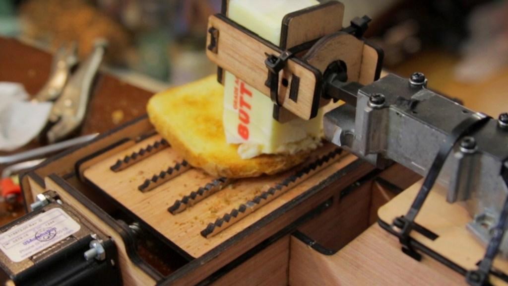 Man Builds a Dangerous Toast Buttering Robot Using a Laser Cutter and a Powerful Jigsaw Motor
