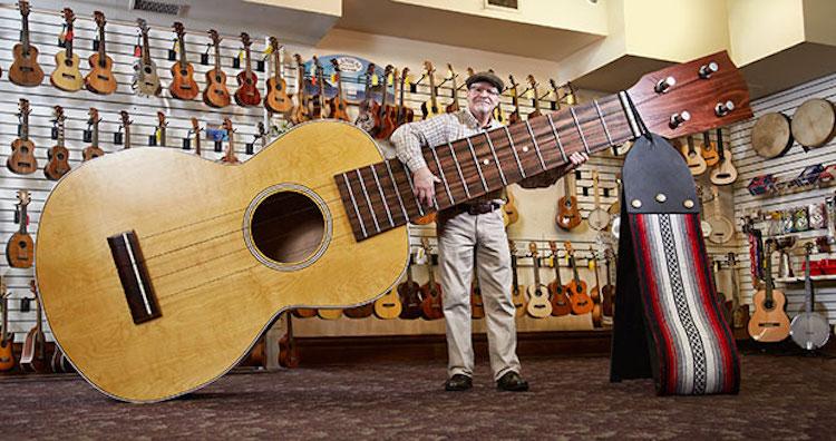 Playing-the-largest-ukulele