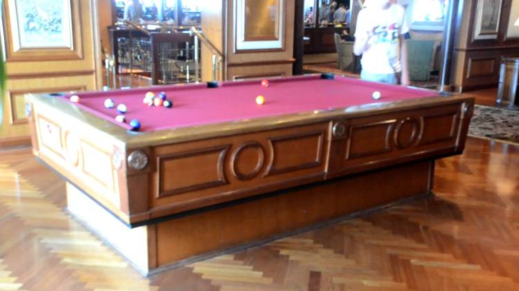 A Game of Pool Being Played on a Gyroscopic Self Leveling Pool Table Onboard a Cruise Ship