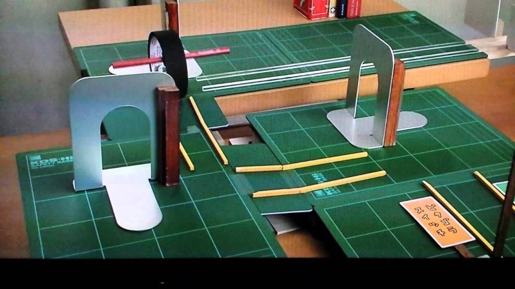 A Roll of Tape Deftly Moves Through a Carefully Arranged Miniature Obstacle Course