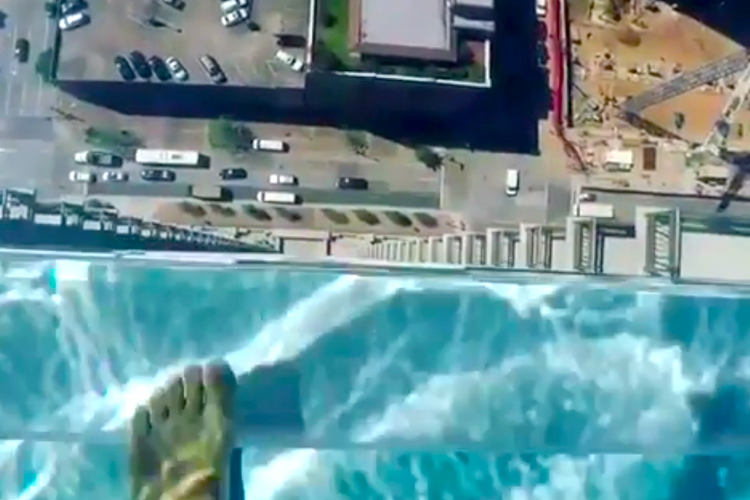Terrifying Glass Bottom Pool in Houston Allows You to Swim 500 Feet Over the City