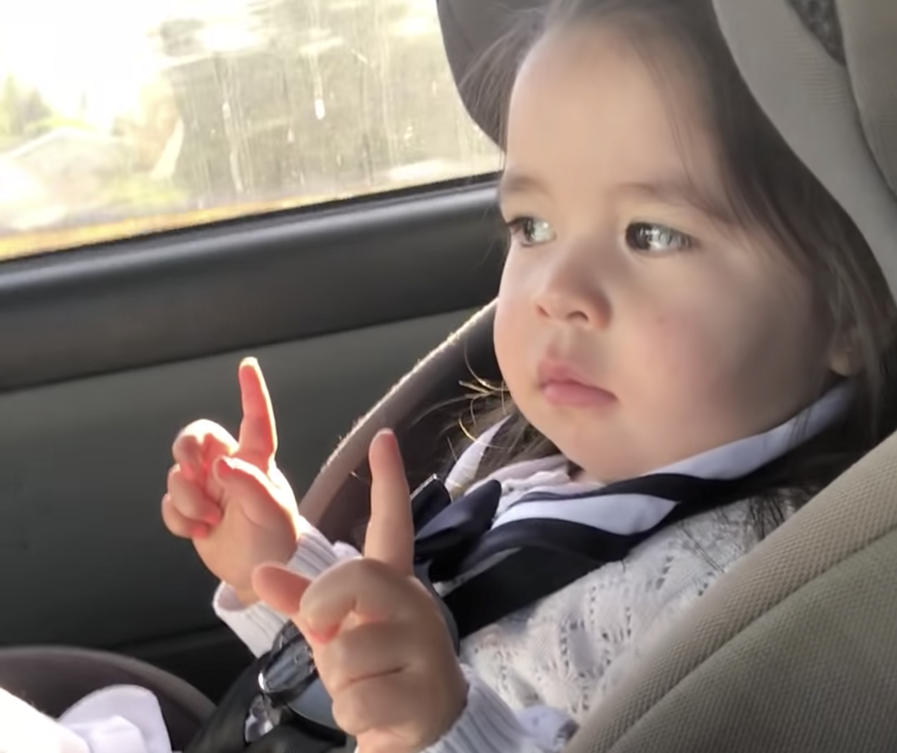 Little Girl in Car Seat Waits for the Beat to Drop in 'Uptown Funk' Before Dancing up a Storm