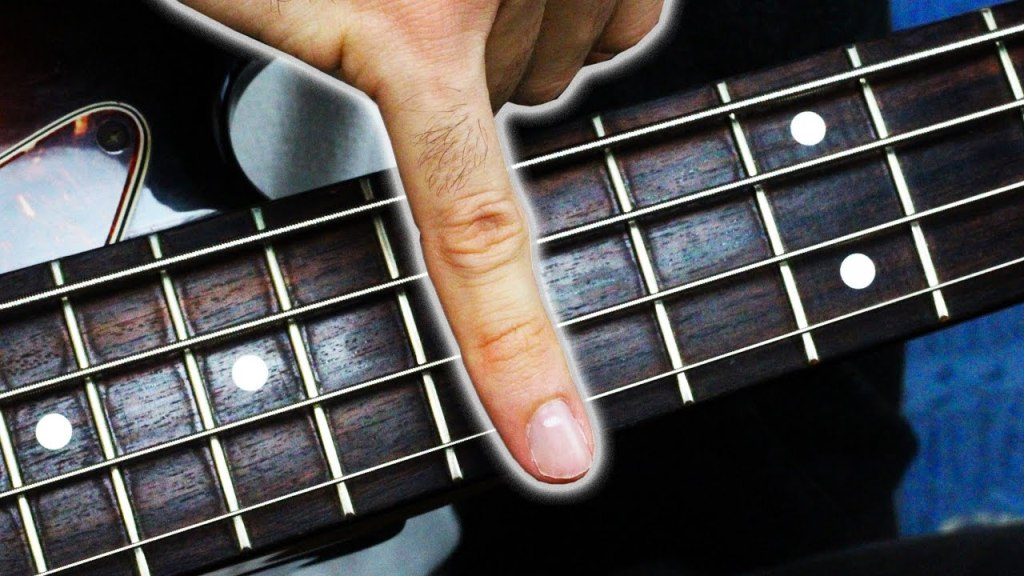 Talented Bass Player Performs an Impressive Solo Using Only His Pinkie Finger
