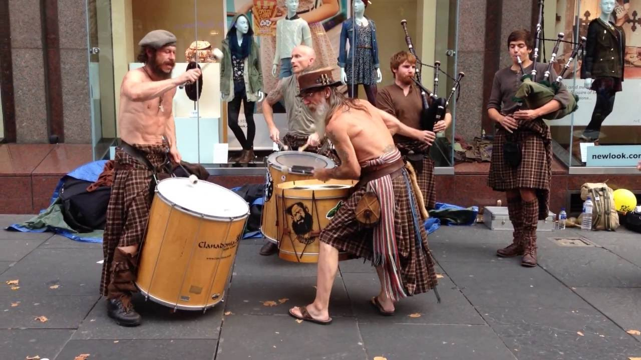 Clanadonia, A Scottish Drum and Pipes Band That Plays Traditional Music Wearing Traditional Clothing