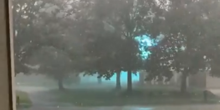 Incredible Video of Glowing Blue Ionized Energy Arcing Across a Power Line During a Storm