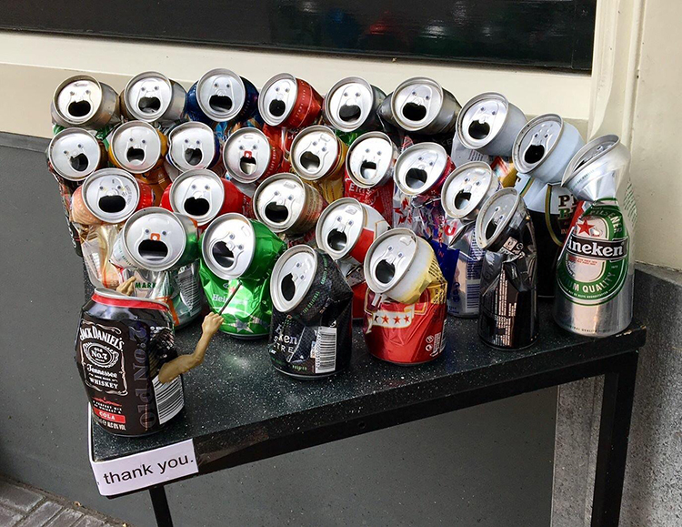 A Collection of Beer Cans That Look Like They Are Putting On a Smashing Choir Performance
