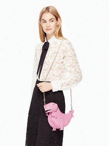 Model with T-Rex Purse