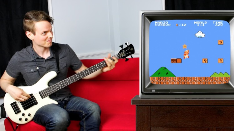 Musician Plays Super Mario Theme Song and In-Game Sound Effects on His Bass Guitar
