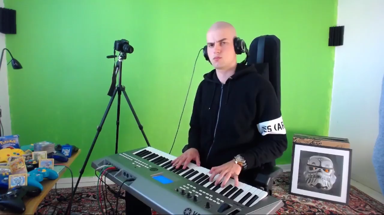 Stern-Faced Keyboardist Performs the Toto Classic 'Africa' In a Variety of Different Genres and Styles