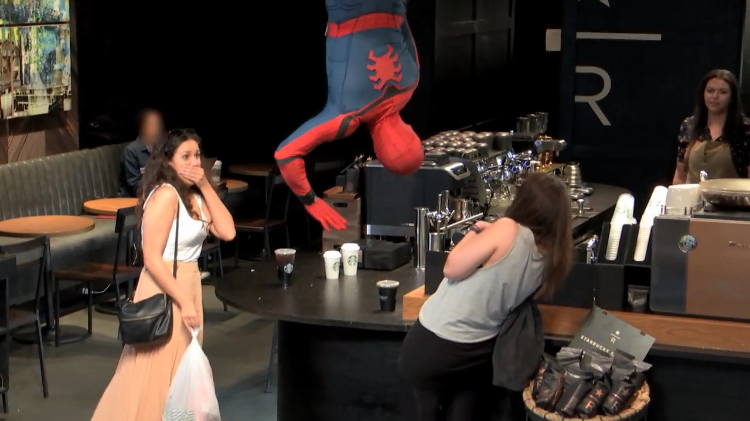 Spider-Man Drops From the Ceiling Surprising Unsuspecting Customers at a NYC Starbucks