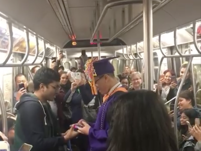 Thoughtful Subway Riders Organize a Graduation Ceremony for a Student Stuck on Delayed Train