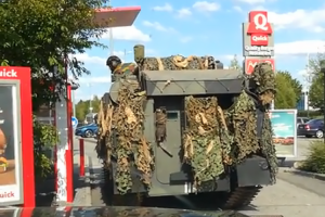 A Belgian Military Tank Orders Food From a Fast Food Restaurant Drive-Thru