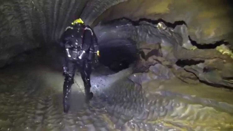 A Team of Divers Explore a Beautiful Air Filled Tunnel Within the Bjuralven Cave System in Sweden
