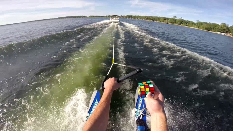 Adventurous Man Solves a Rubik's Cube While Water Skiing Across a Lake