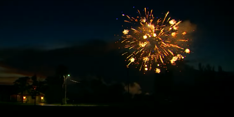 Colorful Fireworks Shoot Across the Sky Against a Gorgeous Backdrop of Cloud Lightning