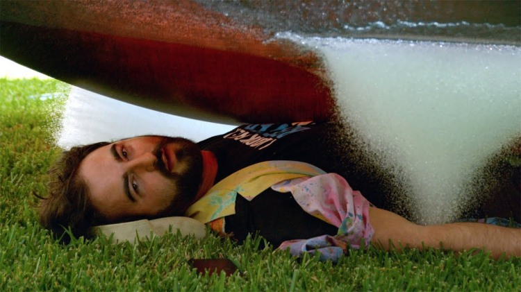 Dan Gruchy of The Slow Mo Guys Gets Showered by a 6 Foot Water Balloon While Under a Trampoline
