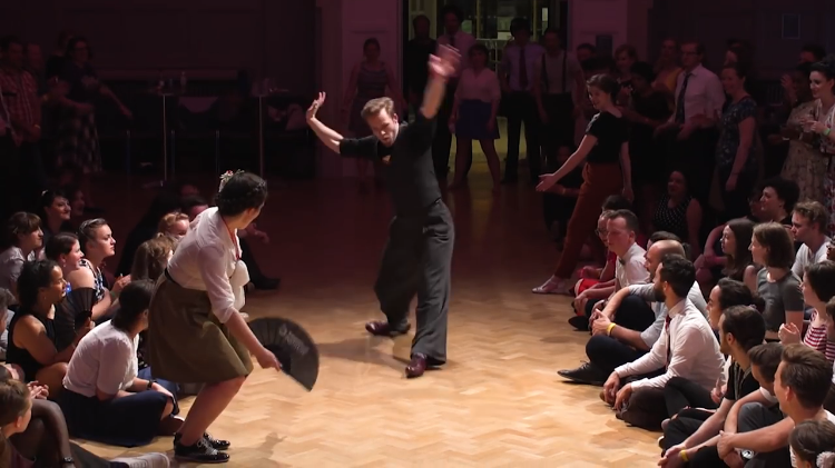 Determined Dancers Face Off by Trying to Complete the Longest Heel Slide Across the Dance Floor