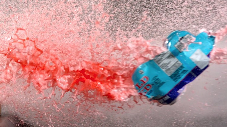 Objects Being Shot With a Compressed Air Cannon Loaded With Maltesers Candy in Super Slow Motion