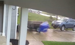 Security Footage of a New York Tornado Lifting an SUV Off of the Ground