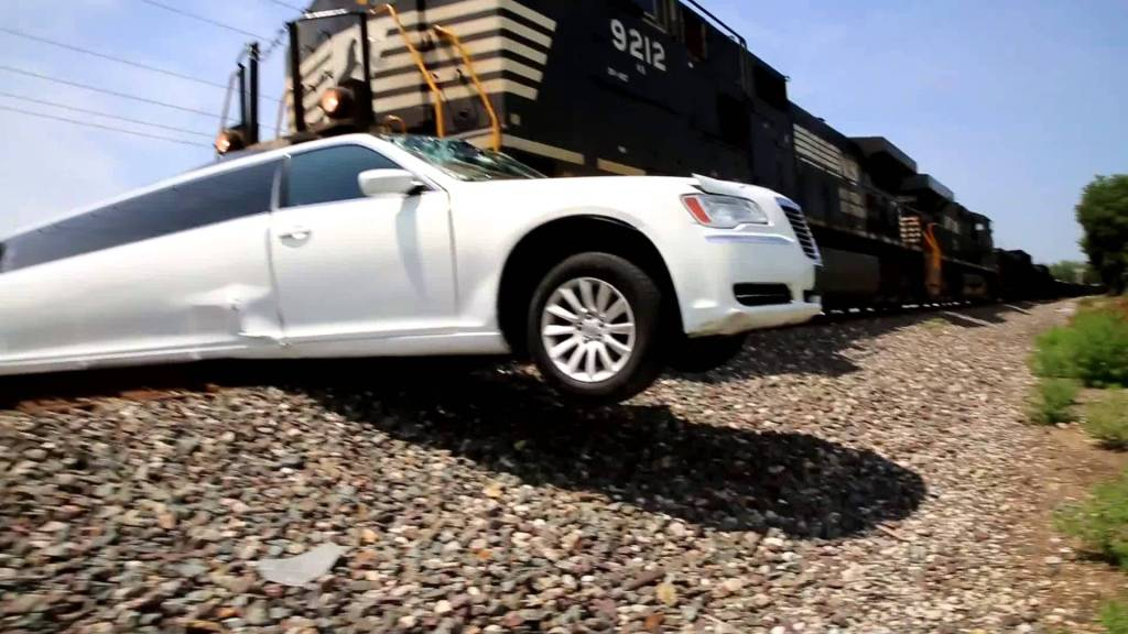 An Incredible Video of a Speeding Train Crashing Into a Stretch Limousine Stuck on the Tracks