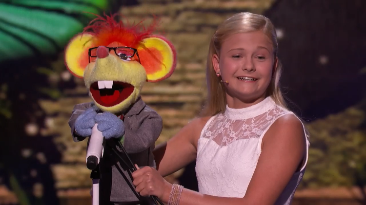 A 12-Year-Old Ventriloquist and Her Cute Mouse Sing The Jackson 5's 'Who's Lovin' You' for Mel B