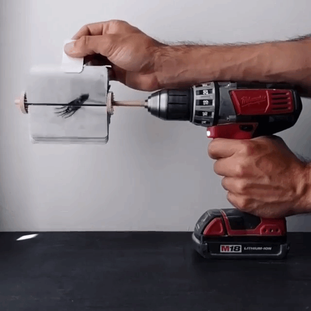 A Brilliant Hand Drawn Flip Board Animation of a Swimming Squid Powered by a Cordless Drill